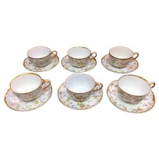 Six matching teacups and saucers by Hutschenreuther, one teacup is repaired