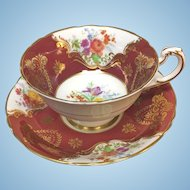 Paragon burgundy gold gilt with colorful summer flowers teacup and saucer set