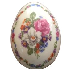 Limoges egg shaped box with flowers and stamped