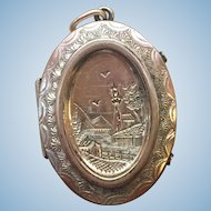 Victorian hand engraved locket with two daguerreotype photos