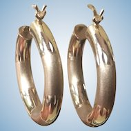 Vintage 14 kt yellow gold 1 inch hoops with smooth and satin finish