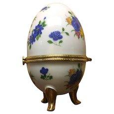 Unmarked Porcelain egg shaped trinket holder.