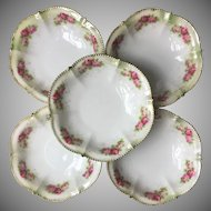 Five vintage porcelain bowls decorated with roses and gold gilt edges