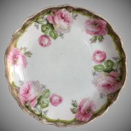 Three Bavarian hand painted rose plates
