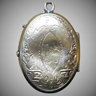 Victorian rolled gold locket hand engraved on both sides.
