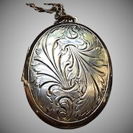 Large vintage locket with chain circa 1970