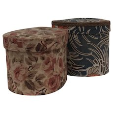 A set of two French 1920s fabric boudoir boxes.