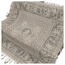 Vintage French mechanical lace bedspread with a cherubs pattern.