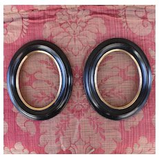 Pair of French oval blackened wood Napoleon III frames.Circa 1880.