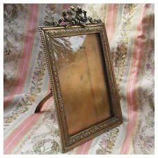 Late 19th French Louis XVI style gilt bronze frame.