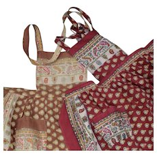 A set of 2 lovely French Provencal fabric bib aprons for little girl.Circa 1950.