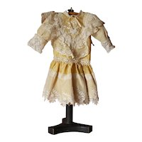 Beautiful French pale yellow silk and lace doll dress.