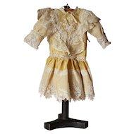 Beautiful French pale yellow silk and lace doll dress.