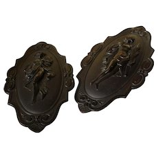 Pair of Antique French Napoleon III gutta percha decorative wall plaques;19th century.