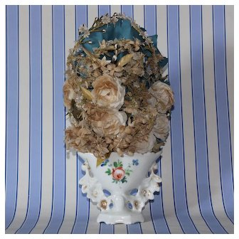 Charming French bridal faded fabric bouquet,in a porcelain wedding vase.Late 19th century.