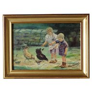 Charming oil on panel '' Children feeding hens and chicks '' signed J Van Arkkels.Circa 1930-1950.