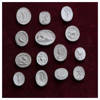 Set of 14  Neoclassical Plaster Cameo Medallions Circa 1830-1850.