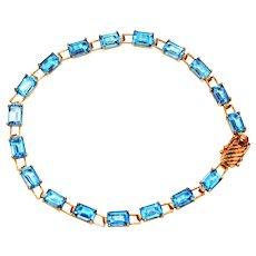 Icy Sparkle 13.50tcw Blue Topaz 10kt Yellow Gold Tennis Bracelet