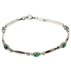 Exceptional 1.25tcw Colombian Emerald 10kt White Gold Tennis Bracelet