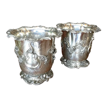 A pair of early Victorian silver-plated wine coolers