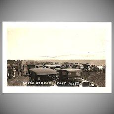 "RPPC Photograph of a ""Smoke Screen Scene at Fort Riley Kansas"""