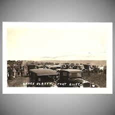 "RPPC Photograph of a ""Smoke Screen Scene at Fort Riley Kansas"""