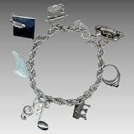 Sterling Silver Charm Bracelet 7 Charms: North Carolina, Piano, Class Ring, Princess Phone, Typewriter, Mortarboard