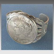 Native American Silver Tone Cuff Bracelet with 1925 Silver Dollar