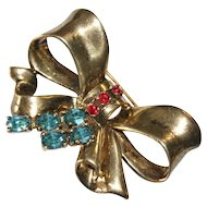 Ciner Gold Washed Sterling Faux Ruby London Blue Topaz Bow Pin