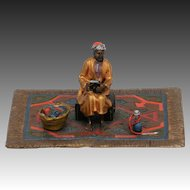 Excellent Austrian Bronze of Seated Arab on Carpet  with Books and Hookah.