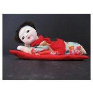 Oriental Doll on Pillow