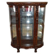 Antique Victorian Carved Figural Quartered Oak Curved Glass Curio Cabinet c1900