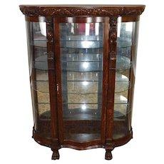 Antique Victorian Carved Figural Quartered Oak Curved Glass Curio Cabinet c1900