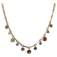 Chaumet 18k Yellow Gold Ruby and Sapphire Necklace and Bracelet Set