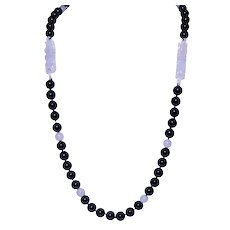 Single Strand Of Black And White Jadeite Beads With Fu Dogs