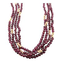 14k Yellow Gold and Garnet bead necklace.