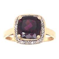 14K Yellow Garnet and Diamond Ring.