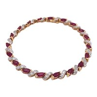 14K Yellow Gold Ruby and Diamond Bracelet.