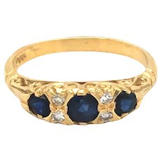 18K Yellow Gold Sapphire and Diamond Gypsy Ring.