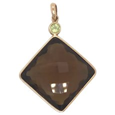 14K Yellow Gold Topaz and Peridot Pendant.
