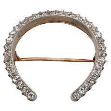 The Horse Shoe Motif Brooch.