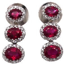 14k White Gold Ruby and Diamond Earring.