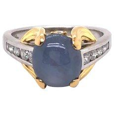 Platinum and 18K Yellow Gold Star Sapphire and Diamond Ring.