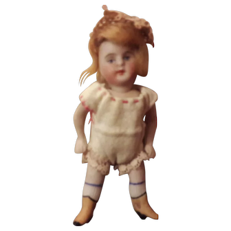 Sweet All Bisque Swivel Head dolly with yellow boots