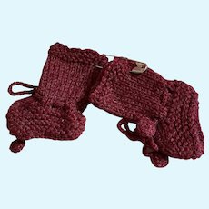 Sweet pair of hand knitted socks for your dolly