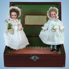 Two Armand Marseille Dolls in a Wooden Box AM 390