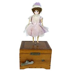 Small Antique Music Box with a Doll