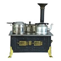 An old Child's Toy Cooker Stove