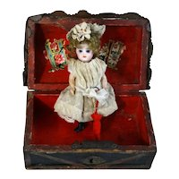 A cute French Mignonette Doll in a Box