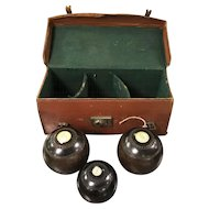 Three wooden bowls with leather case